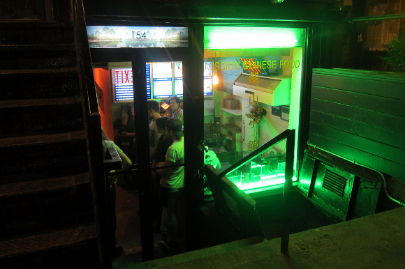 The neon-green glow of Mission Chinese's storefront. (Wally Gobetz)