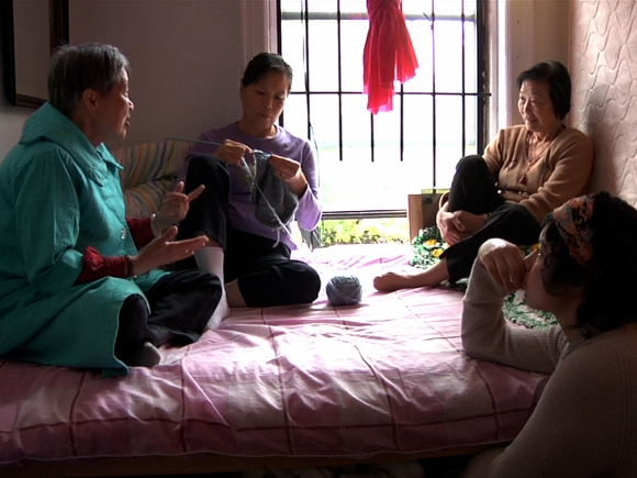 Sachs recruited performers for the film, like those here on a shared bed, from the Lin Sing Association, a welfare and rights organization in Chinatown.