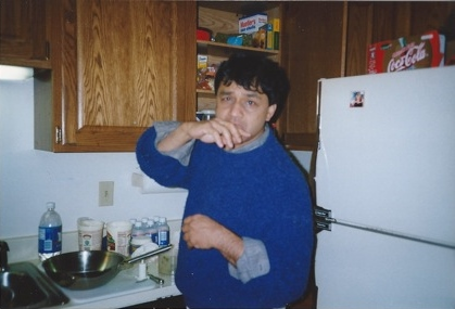 Shahid at home in his kitchen in Northampton, MA, in 1997. Photo courtesy Sejal Shah.