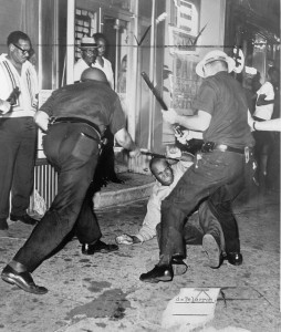 "Tensions boiled over in the months after the ""Fruit Riot"" incident, resulting in the Harlem Riots of 1964. The violence between civilians and police continued (here, at 133rd St and Seventh Avenue) over the next six days. Courtesy of Wikipedia."