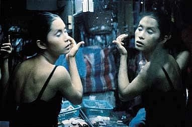 """C putting on her make-up at Second Tip,"" Nan Goldin, 1992."