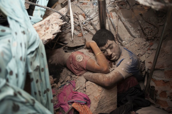 Garment Workers in Deathtrap. Two victims embrace amidst the rubble of the Rana Plaza building, a garment factory in Savar, Dhaka that collapsed on April 24, 2013.  TASLIMA AKHTER