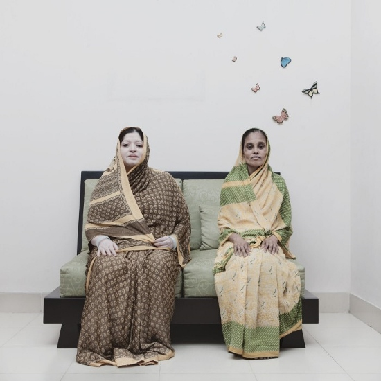 57-year-old housewife Anjumanara (left) with 50-year-old Jibonunneesa, who works as a home servant in Anjumanara 's house in Green Road, Dhaka.