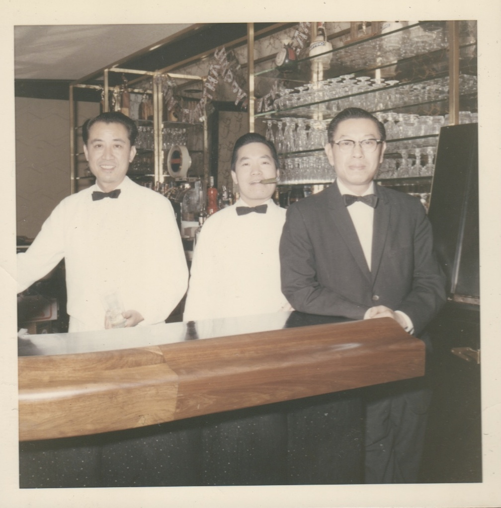 The author's grandfather (far left) takes a break with two co-workers at a restaurant in Manhattan's Chinatown.