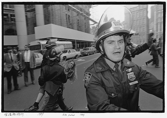 A photograph by Ai Weiwei of a woman getting arrested during an AIDS protest in New York City in 1989.