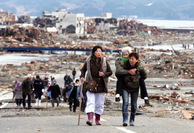Women leaving Tohoku after the March 2011 earthquake and tsunami. Photo courtesy Warren Antiola.
