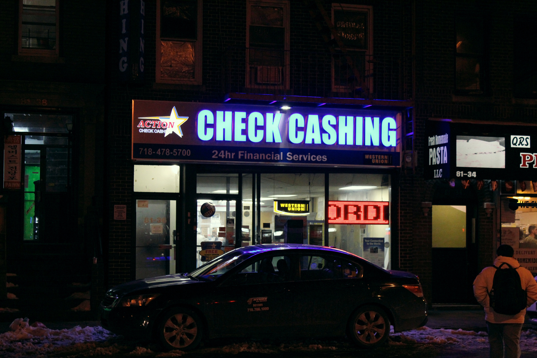 As a result of a strong distrust of banks and challenges like lack of in-language services, immigrants are continuing to use alternative financial services, like this check cashing business in Elmhurst. (Photo by Alex Wen)