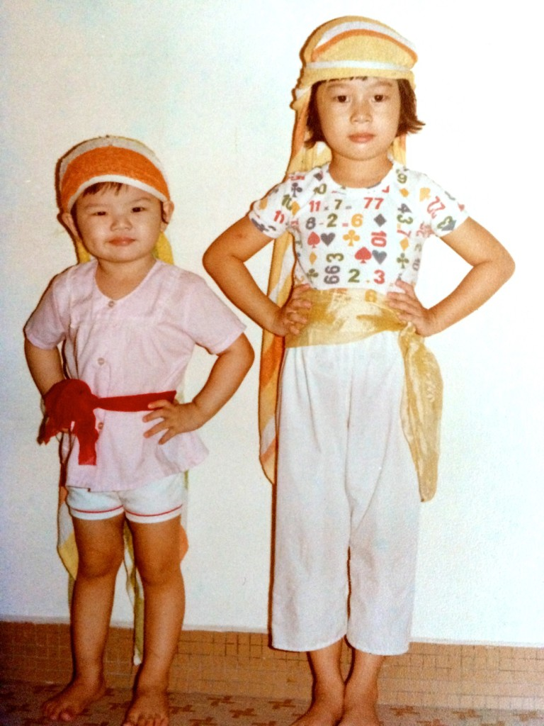 Inspired by Chinese opera classics on radio, the author (age 5) and her cousin (age 3) were forever acting. Here they are bandits in authentic period costume dating from an unknown dynasty.