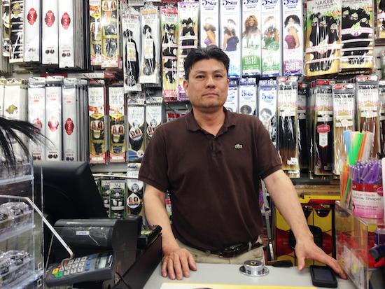 John Bang, the owner of Hopkins Beauty Supply in Baltimore's Sandtown neighborhood.
