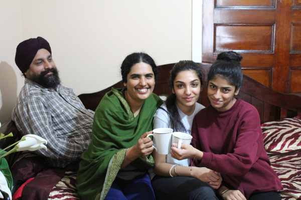 While everyone's busy schedule makes it hard for the family to have cha together every day, Jasdeep Singh, Parminder Kaur, Anmol Kaur, Avneet Kaur, and Karanbir Singh (not pictured) make it a point to have cha together on weekends. Photo by Sonny Singh