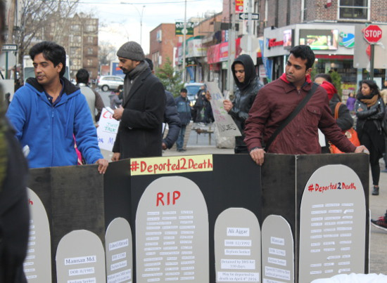 "Protestors hold cardboard gravestones. The headstones were filled with lists of Muslim names and brief synopses of individual migration stories: ""Al Amin; DOB 2/1990; Asylum Seeker; Walked over 3,000 miles through 14 countries."""