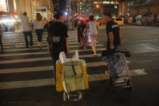 """Bai and other vendors start their trek from 42nd Street to """"The Block."""""""