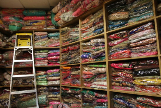 The backroom of Pashmina Fashion is stock full of sarees, lehengas, and other formal South Asian clothing.