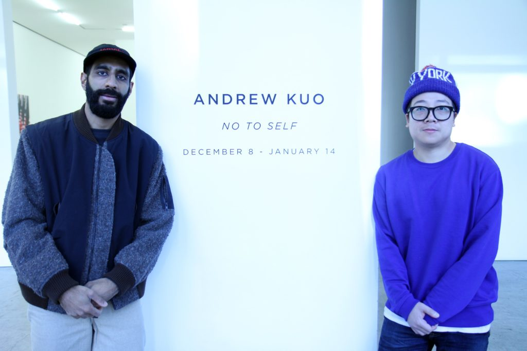 Ashok and Andrew Kuo stand in front of Andrew's gallery exhibition at the Marlborough Gallery in Chelsea.