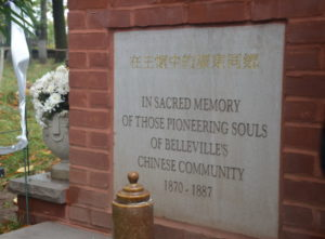 "The inscription on the gravestone that says, ""Cantonese in the Arms of Jesus""."