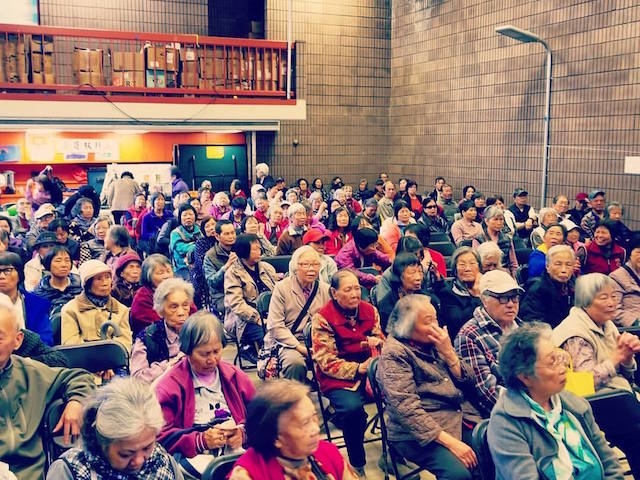 Elderly residents of Chinatown at a presentation